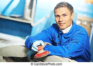auto mechanic with polishing sander