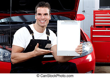 Auto mechanic with tablet.