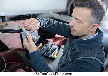 auto mechanic working in garage