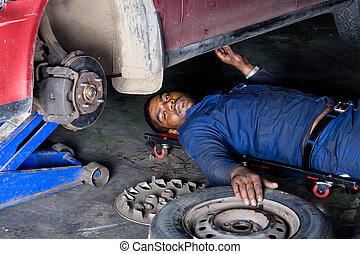 auto mechanic working - an auto mechanic about to go under...
