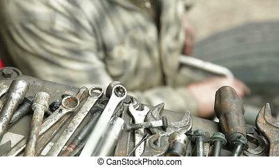 Auto Mechanic Works With Wrench