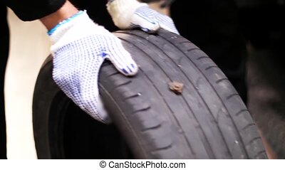 auto mechanics repairing wheel tire with blowout - car...