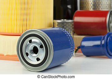 Auto oil filter on a various filter background