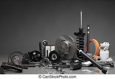 Auto parts - New car parts on a gray background