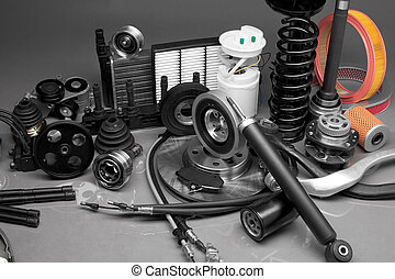 Auto parts - New parts for motor vehicles on a gray ...