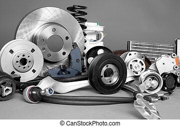 Auto parts - New car parts on a gray background closeup