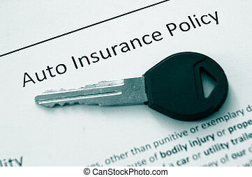 auto policy - closeup of an auto insurance policy and car...