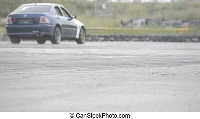 Auto racing burning rubber on the wheels