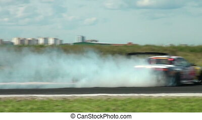 Auto racing. The smoke from under the tires