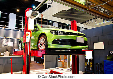 Auto Repair. - Car lifted up on the repair stand at garage