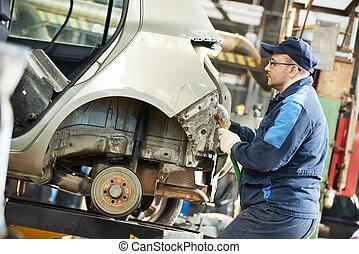 auto repair man flatten metal body car