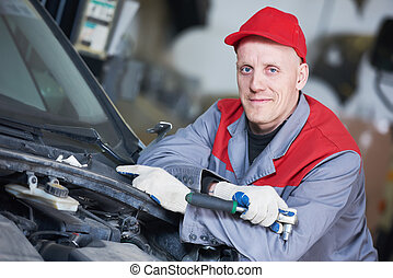 Auto repair service. Mechanic worker portrait with spanner