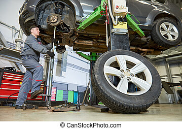 Auto repair service. Mechanic works with car