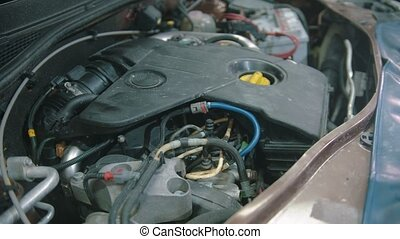 Auto repair shop - working engine under the car hood. Mid ...