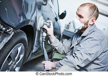 auto repairman grinding automobile car body - Auto body...