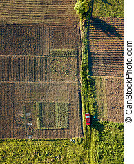 Auto rides on the road between fields for sowing - Aerial ...