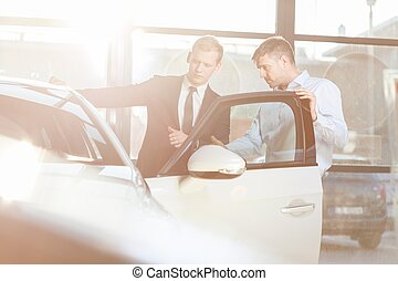 Auto salesman and customer - Photo of auto salesman and...