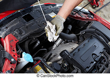 Auto service - Oil level checking. Mechanic in auto repair ...
