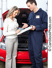 Auto shop - Handsome mechanic working in auto repair shop.