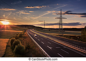 autobahn - stretch of motorway in Germany by setting sun