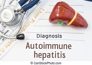 Autoimmune hepatitis diagnosis. Anatomical 3D model of human liver is near stethoscope, results of laboratory tests of liver function and printed on notepad diagnosis of Autoimmune hepatitis