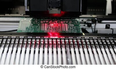 Automated Electronic circuit board production close up....