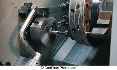 Automated lathe processes the part and creates a thread....