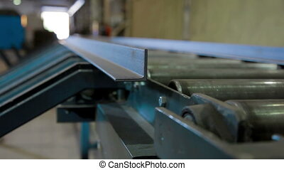 Automated machine cuting metal in Industrial factory -...