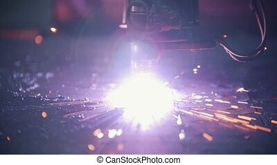 Automated milling machine creates holes in a metal sheet....