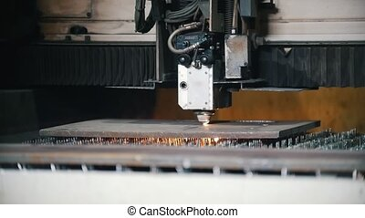 Automated milling machine slowly cuts the metal surface....