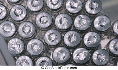 Pharmaceutical industry, manufacturing, medicine and automated pharma technology equipment concept - conveyor belt with empty glass bottles - pharmaceutical automatic production line - top view