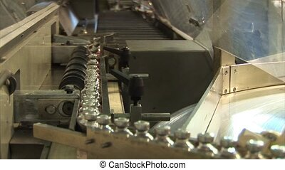 Automated production of medicines. Filling drug vials....