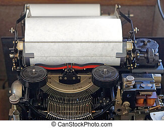 Automated typewriter machine with white paper in roll