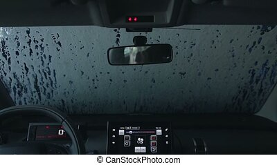 Automatic car wash brushes during washing process - View...