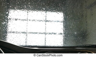 Automatic car wash seen from inside of a vehicle