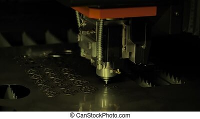 Automatic cnc laser cutting machine working with sheet metal with sparks