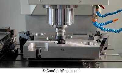 automatic cutting machine is carving holes in a metal detail...