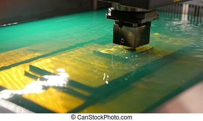 Automatic factory - cutting of sheet metal process in water, front view