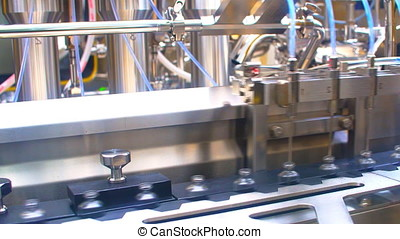 Automatic filling machine for the production of medicines in ampules.