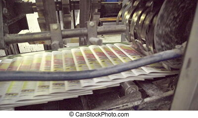 Automatic line with moving newspapers on machine in printing house