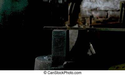 Automatic mechanical hammering. Blacksmith hammering iron ...