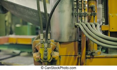Automatic metal press making part of the tank - Close up of...