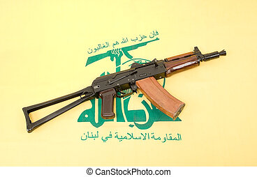 Automatic rifle and flag of Hezbollah