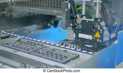Automatic SMD pick and place machine assembling computer printed circuit board