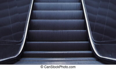 Automatic stairs of escalator moving up in shopping mall without people. Public transportation system, modern building and architecture concept