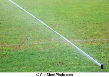automatic watering system on grass - automatic watering...