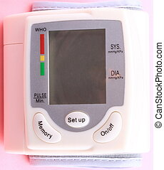 Automatic Wrist Digital blood pressure monitor on pink background at dry day
