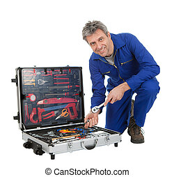 Automechanic taking a wrench out of toolbox