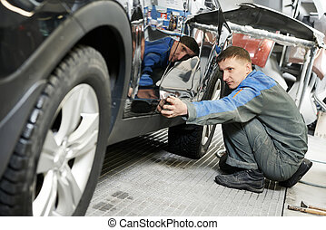automobile car body paint check - auto repairman worker in...