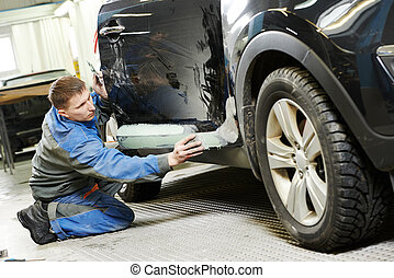 automobile car body stopping - repairman worker in...